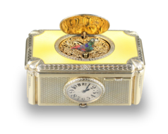 Silver gilt and enamel singing bird box with timepiece, by C. H. Marguerat