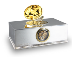 Contempary sterling silver, gold and diamond singing bird box with timepiece, by Reuge
