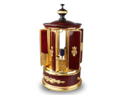 A contemporary maroon lacquer and metal gilt singing bird cigar dispenser carousel, by Reuge