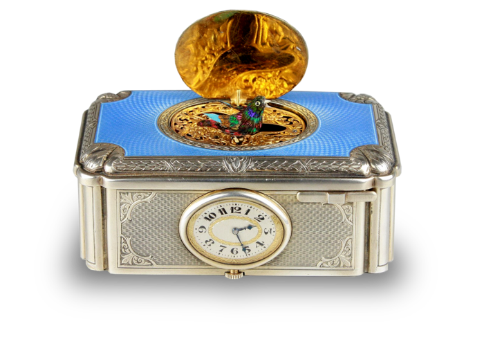 A very fine silver gilt and enamel singing bird box with timepiece, by C. H. Marguerat