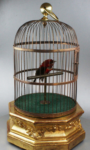 A large Antique hexagonal base antique single singing bird-in-cage, by Bontems