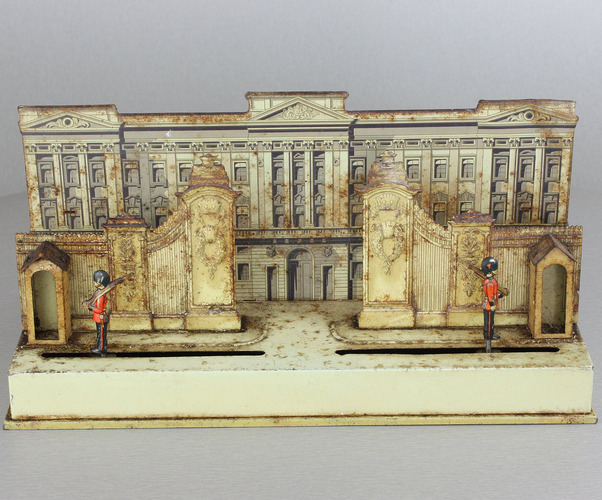 A small and unusual lithographed tinplate automaton  - 'The Changing of the Guard at Buckingham Palace'