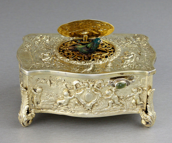 Vintage silver-gilt bow-front form singing bird box, by Karl Griesbaum