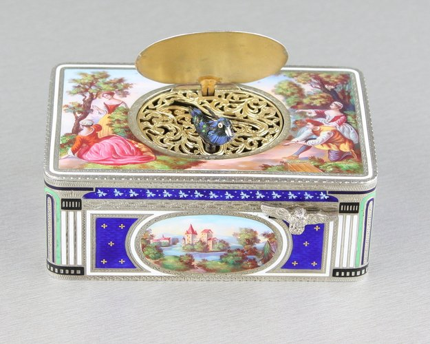 A very fine Sterling silver gilt, enamel and pictorial enamel singing bird box, by Karl Griesbaum