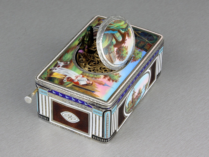An exceptional silver and full pictorial enamel singing bird box, by Karl Griesbaum, Model 7, circa 1930