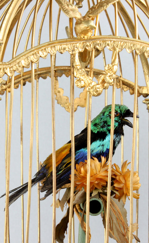 A stunning and very fine gilt bronze and Sevres plaque single singing bird-in-cage, by Bontems